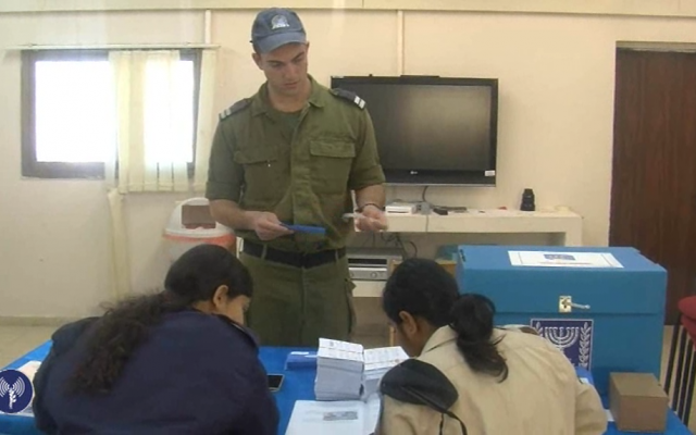 An IDF sailor casts his ballot early on Sunday ahead of Tuesday's parliamentary elections. (photo credit: image capture from IDF Spokesperson video)
