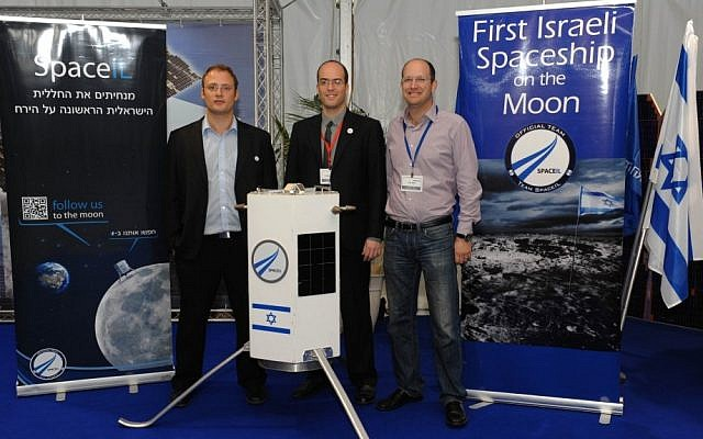 Three of SpaceIL's founders -- Yariv Bash, Yonatan Winetraub, and Kfir Damari -- with a model of the spacecraft they propose to send to the moon (photo credit: Alon Hadar)