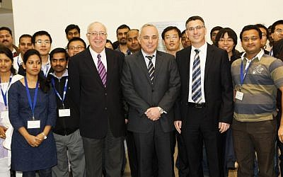 R to L, forefront) Education Minister Gideon Sa'ar, Finance Minister Yuval Steinitz, and Professor Manuel  Trajtenberg, chairman of the Israel Council for Higher Education, welcome post-doctoral students from India and China Sunday (Photo credit: Education Ministry)