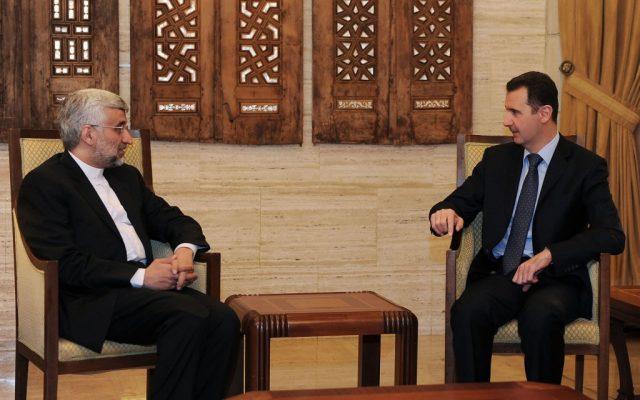 Saeed Jalili, left, meeting with Bashar Assad in Damascus on Sunday. (photo credit: AP/SANA)