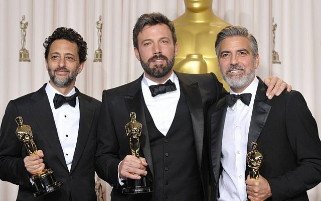 "Ben Affleck (center) with Grant Heslov (left) and George Clooney pose with their awards for best picture for ""Argo"" during the Oscars at the Dolby Theater in Los Angeles on February 24, 2013. (photo credit: John Shearer/Invision/AP)"