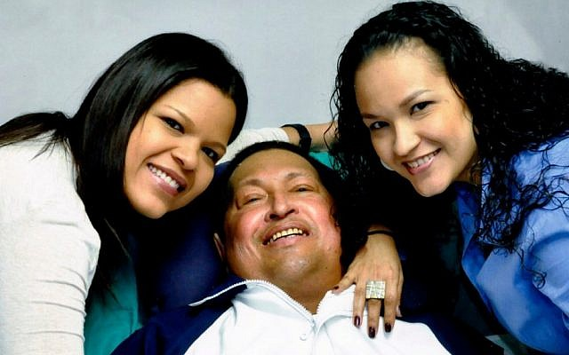 In this photo released in January, Venezuela's President Hugo Chavez, center, poses for a photo with his daughters, Maria Gabriela, left, and Rosa Virginia at an unknown location in Havana, Cuba (photo credit: AP/Miraflores Presidential Press Office)