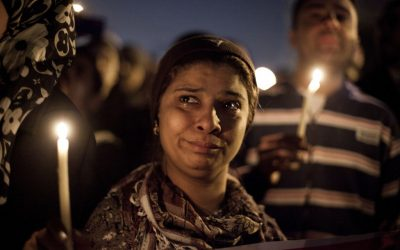 Illustrative photo of demonstrators with candles at a street memorial in Cairo, Egypt, on February 2, 2013. (photo credit: AP/Virginie Nguyen Hoang)