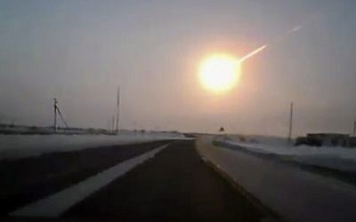 A meteor streaks across the sky of Russia's Ural Mountains in February 2013, causing sharp explosions and reportedly injuring hundreds of people, including many hurt by broken glass. (AP Photo/Nasha gazeta, www.ng.kz)