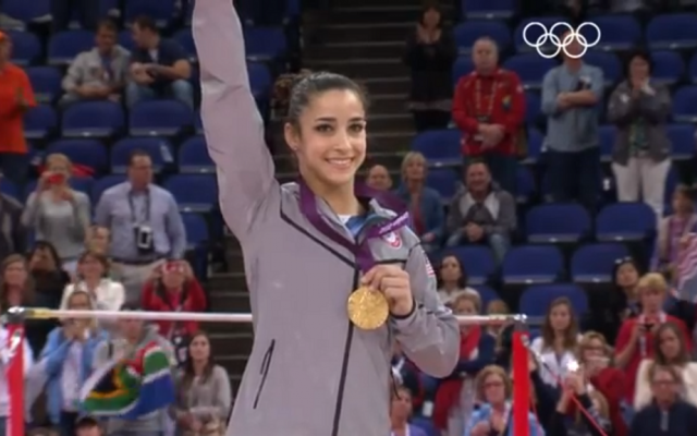 Jewish-American Olympic gymnast Aly Raisman holding a gold medal at the 2012 Olympic Games in London. (photo credit: screen capture, YouTube)