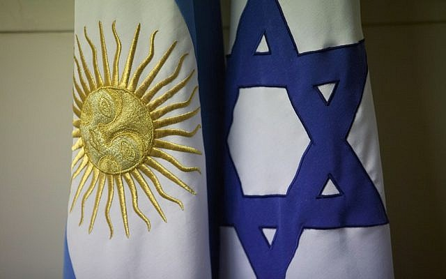 An Argentine and Israeli flag stand side by side at the office of Guillermo Borger, president of the Jewish community center AMIA, Argentina. (AP Photo/Victor R. Caivano)