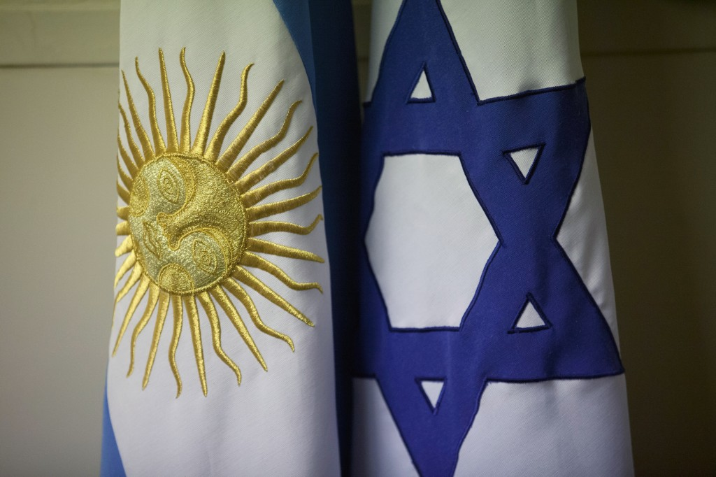 An Argentine and Israeli flag stand side by side at the office of Guillermo Borger, president of the Jewish community center AMIA, Argentina. Argentine Jewish organizations rejected on Thursday a plan announced by Argentine President Cristina Fernandez to establish a truth commission with Iran to clarify the 1994 terrorist attack against AMIA that killed 85 people. In the past, Argentine prosecutors had blamed Iran for the attack. (AP Photo/Victor R. Caivano)
