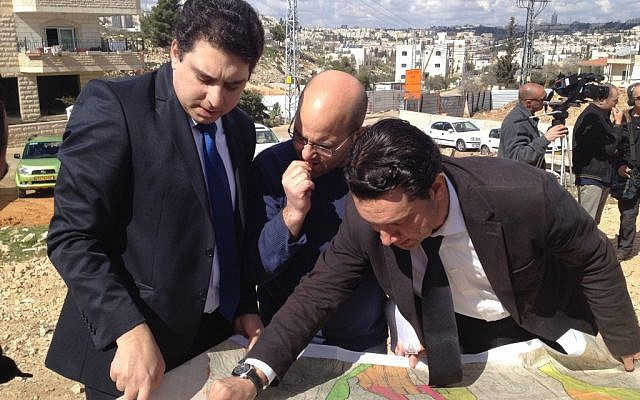 Lawyers for Beit Safafa residents display construction plans at a press conference on Monday, February 18 (Matti Friedman/Times of Israel)