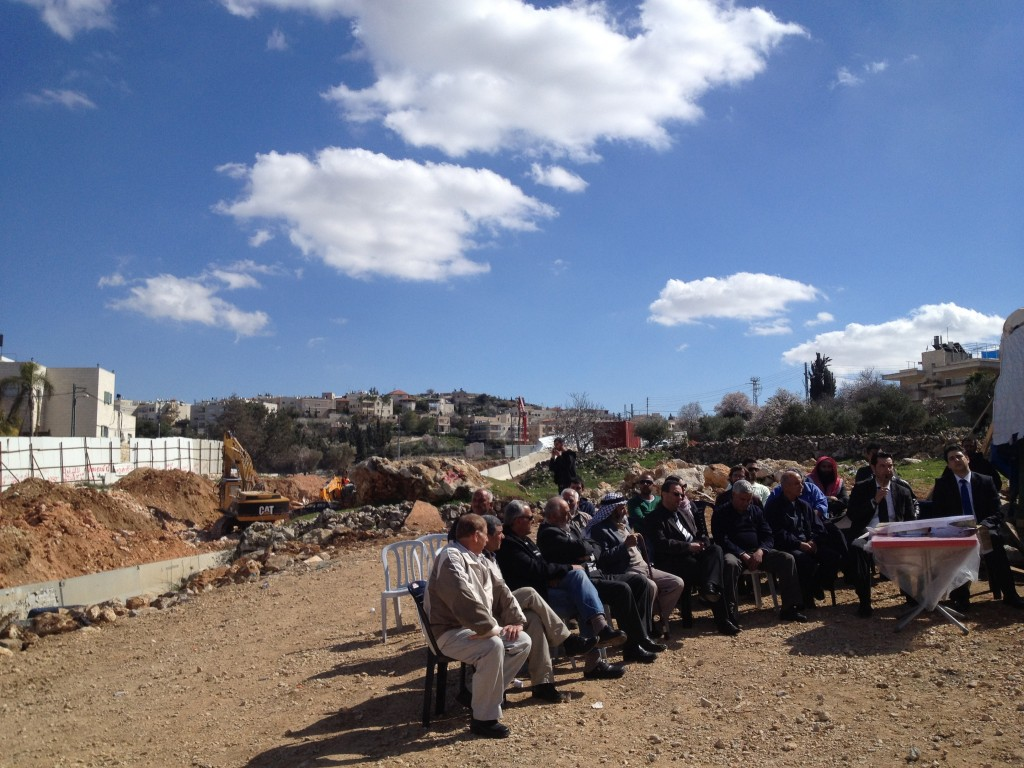 Beit Safafa residents gather near the site of the new highway through their neighborhood, Monday, February 18 (Matti Friedman/Times of Israel)