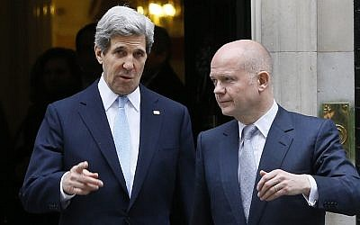 US Secretary of State John Kerry, left, walks with British Foreign Secretary William Hague in London in February. The two leaders are taking part in a G8 foreign ministers meeting Wednesday and Thursday, also in London. (photo credit: AP Photo/Kirsty Wigglesworth)