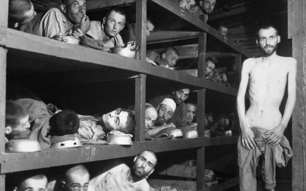 Inmates at the Buchenwald concentration camp, days after liberation. Famed author Elie Wiesel is second row from the bottom, seventh from the left, next to the bunk post. (US Army/US Defense Visual Information Center/Wikimedia Commons)