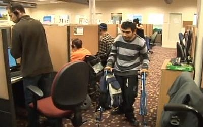 Disabled employees report to work at Call Yachol (photo credit: image capture YouTube)
