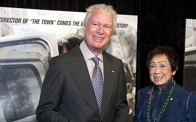 Former Canadian Ambassador Ken Taylor and his wife, Pat, pose for photographers at the premiere of the film Argo in Washington, DC, last October (photo credit: AP/Cliff Owen)