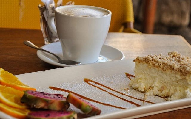 Cheesecake and a cappuccino at the Napoleon Patisserie (photo credit: Michal Shmulovich/Times of Israel)