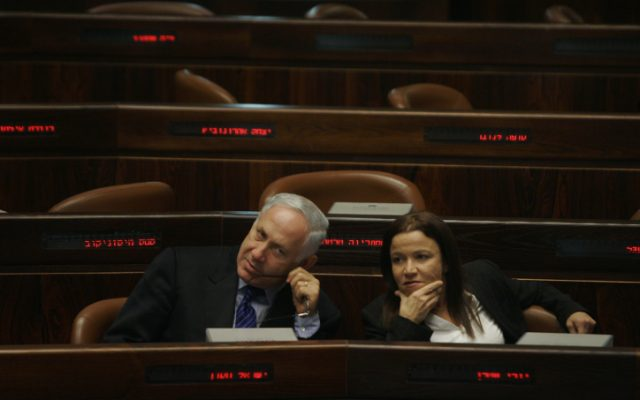 Prime Minister Benjamin Netanyahu and Labor Party leader Shelly Yachimovich speak during a meeting at the Knesset (photo credit: Michal Fattal/Flash90)