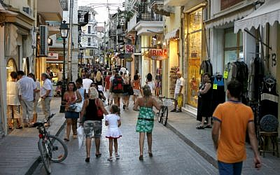 Tourists pound the pavements of Rethymno in the Greek island of Crete (photo credit: Nati Shohat/Flash90)