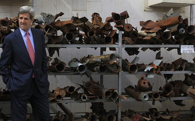 John Kerry examines the remains of rockets fired by Palestinian militants in Gaza, at a police station in the southern town of Sderot, during a regional visit in 2009 (photo credit: Tsafrir Abayov/Flash90)