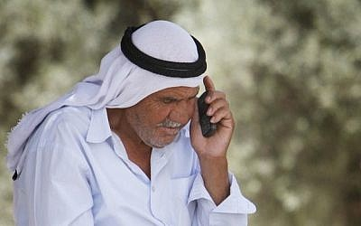 An Israeli Arab speaks on a cellphone (Miriam Alster/Flash90)