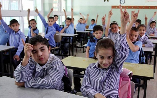 Palestinian children attend the first day of school in the West bank city of Ramallah. September 4, 2011 (Issam Rimawi/Flash90)
