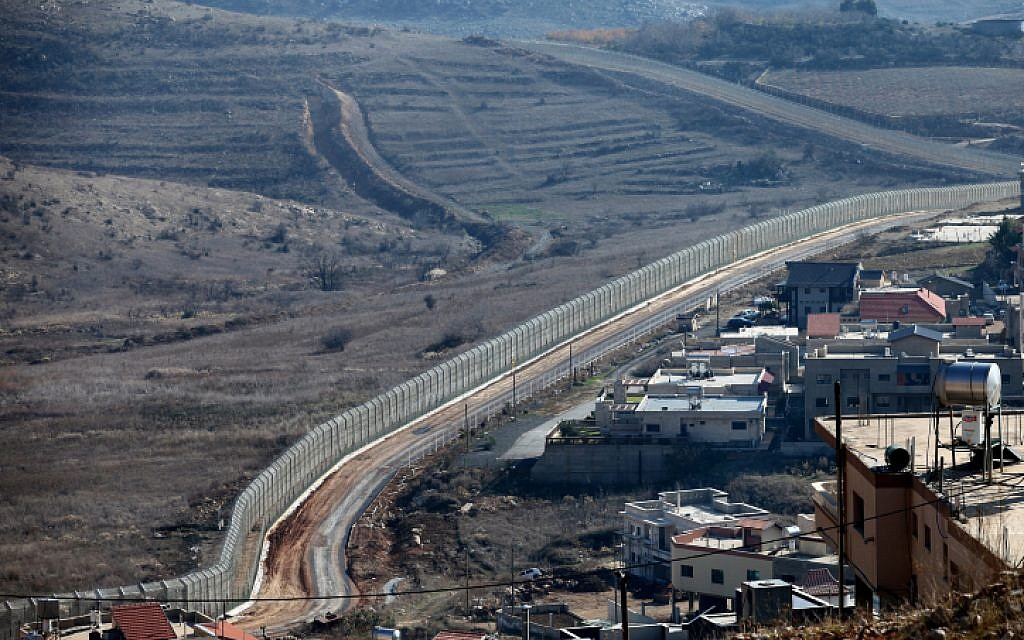 The new border fence as seen from the Druze village of Majdal Shams (Photo credit: Moshe Shai/ Flash 90)