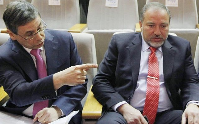Former deputy foreign minister Danny Ayalon (left) with ex-foreign minister Avigdor Liberman in the Knesset in 2012 (Photo credit: Miriam Alster/FLASH90)