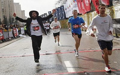 """I'd like to see more ultra Orthodox runners, and more Arab runners,"" said Rachel Neiman, who regularly runs in Jerusalem. Here, crossing last year's finish line (photo credit: Miriam Alster/Flash 90)"
