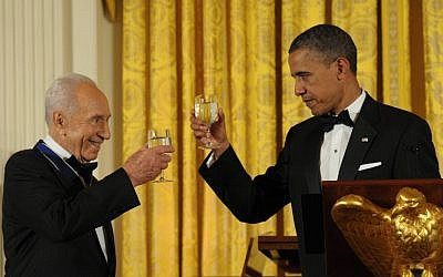 Obama and Peres toasting at the ceremony where Obama presented Peres the Presidential Medal of Freedom in June 2012. (photo credit: Amos Ben Gershom/ GPO/Flash90)