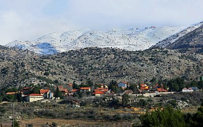 The northernmost Jewish village in the Golan, Neve Ativ, beneath Mount Hermon (photo credit: Moshe Shai/Flash 90)