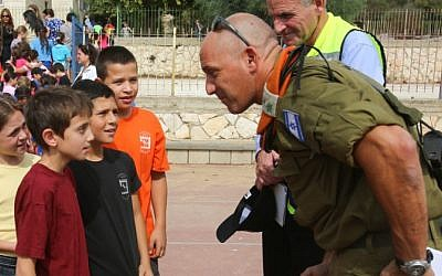 An officer from the Home Front Command talks to students during an emergency drill at an Israeli school, October 2012 (photo credit: Oren Nahshon/Flash90)