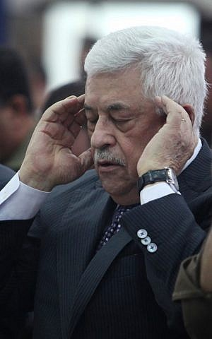 A dismayed Abbas massages his temples during Sunday's press conference (photo credit: Issam Rimawi/Flash90)