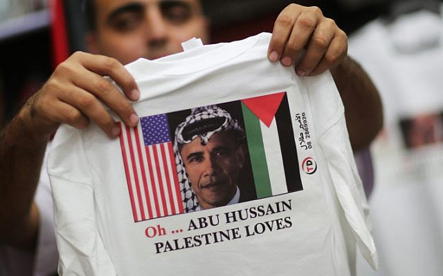 A vendor displays T-shirts for US President Barack Obama at his souvenir shop in Gaza City (photo credit: Wissam Nassar/Flash90)