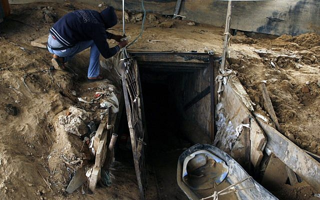 A Palestinian man works outside a smuggling tunnel which connects the Gaza Strip and Egypt in Rafah, southern Gaza Strip on November 24, 2012 (photo credit: Abed Rahim Khatib/Flash90)