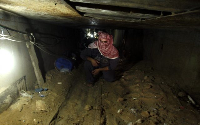 A Palestinian man works inside a smuggling tunnel which connects the Gaza Strip and Egypt in Rafah, southern Gaza Strip, November 24, 2012 (photo credit: Abed Rahim Khatib/Flash90)