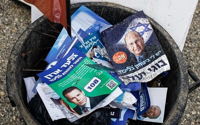 Discarded campaign flyers rest in a trash can following the Likud party primaries on Nov 25, 2012 (photo credit: Uri Lenz/Flash90)