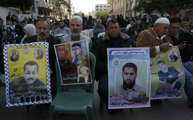 Palestinians rallying in November 2012 for hunger-striking prisoners to be released. (photo credit: Abed Rahim Khatib/Flash90)