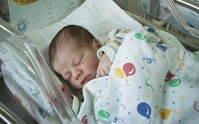Illustrative photo of a newborn baby (photo credit: Moshe Shai/Flash90)
