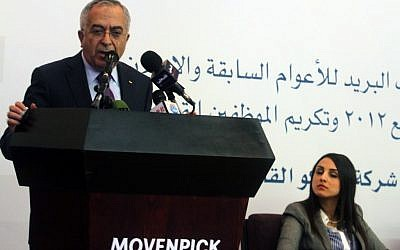 Palestinian prime minister Salam Fayyad participates in the unveiling of the first postage stamp bearing the name of the State of Palestine on January 28, 2013 (photo credit: Issam Rimawi/Flash90)