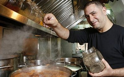 Avi Levy in his HaMotzi kitchen (photo credit: Miriam Alster/Flash90)