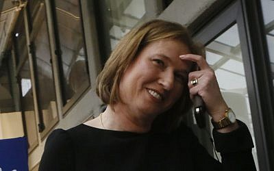 Oops. Tzipi Livni and her smartphone (photo credit: Miriam Alster/Flash90)