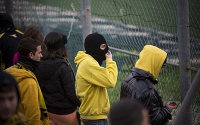 Fans of Beitar Jerusalem protest the decision to sign two Chechen Muslim players during training session in Jerusalem, on February 1, 2013. (photo credit: Yonatan Sindel/Flash90)