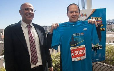 Mayor Nir Birkat, gearing up with his new, Jerusalem Marathon 2013 shirt (Courtesy Flash 90)
