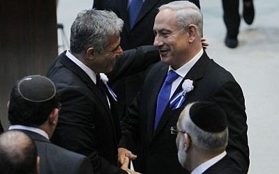 Prime Minister Benjamin Netanyahu with Yesh Atid leader, Yair Lapid, at the opening session of the Knesset, February 5, 2013 (photo credit: Miriam Alster/Flash90)