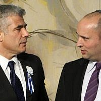 Finance Minister Yair Lapid, left, and Economy Minister Naftali Bennett at the opening session of the Knesset in January, 2013. (Miriam Alster/Flash90)