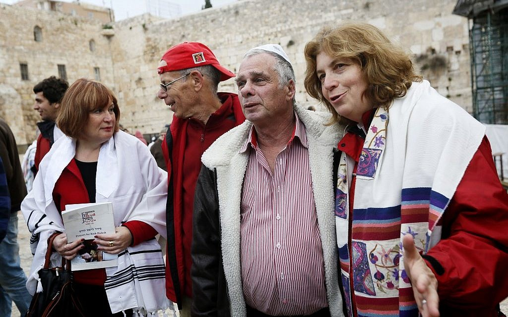 Women of the Wall Anat Hoffman (right) and Lesley Sachs (left), with two paratrooper veterans, shortly before the women were arrested near the Western Wall on Monday (photo credit: Miriam Alster/Flash 90)