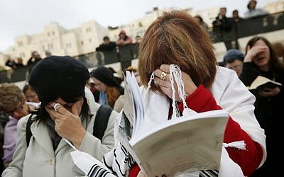 Members of the Women of the Wall wear prayer shawls as they pray at the Western Wall on February 11, 2013. (photo credit: Miriam Alster/Flash90)