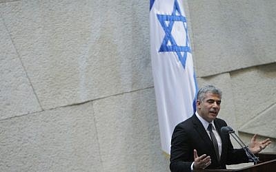 Yair Lapid addresses the Knesset for the first time Monday. (photo credit: Miriam Alster/Flash90)