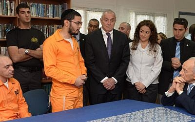 President Shimon Peres (far right) and Minister of Internal Security Yitzhak Aharonovich (center) visit the Ayalon prison Tuesday (photo credit: Moshe Milner/GPO/Flash90)
