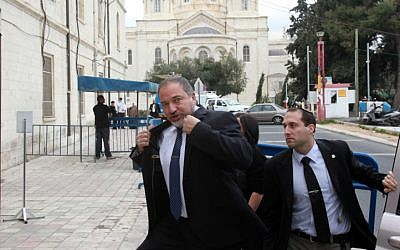 Former foreign minister Avigdor Liberman makes his way to Jerusalem Magistrate's Court Sunday February 17, 2013, to begin his trial on charges of fraud and breach of trust. (photo credit: Yossi Zamir/Flash90)