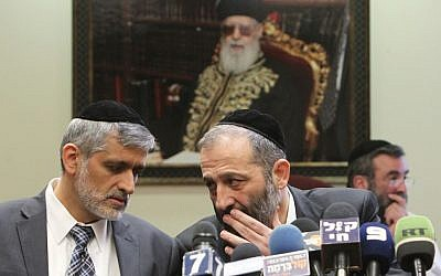 Shas leaders Eli Yishai (left) and Aryeh Deri during a Shas party meeting in the Knesset on February 18, 2013. (Photo credit: Miriam Alster/FLASH90)