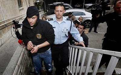 Police bring two suspects arrested for arson at the Beitar Jerusalem football team's office to the Magistrate's Court in Jerusalem on February 19, 2013. (photo credit: Miriam Alster/Flash90)